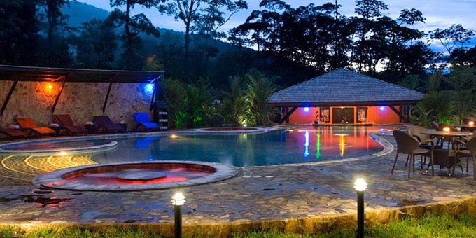 Rio Celeste Hideaway is a luxury bungalow style hotel located near Rio Celeste Waterfalls and Volcan Tenorio National Park.  Hotel amenities include swimming pool, jacuzzi, restaurant, bar, nature trails, tropical gardens, and internet.