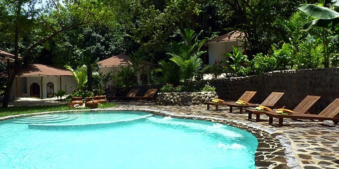 Manala Hotel is a bungalow style boutique hotel located within walking distance to the surfing beach, Playa Santa Teresa.  Hotel amenities include swimming pool, jacuzzi, tropical gardens, and internet.