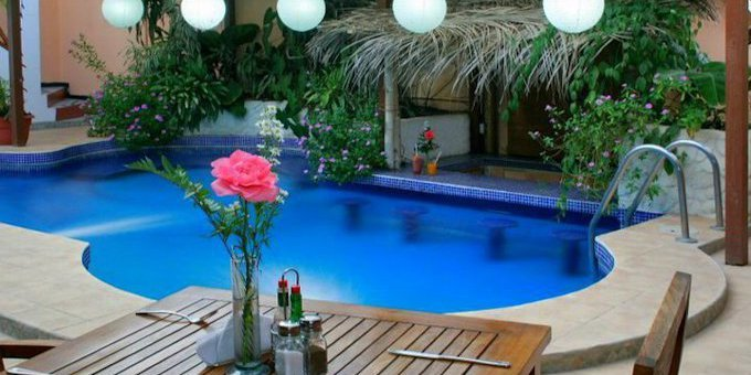 Hotel Poseidon is a boutique style hotel located a half block from the beach at Playa Jaco.  Hotel amenities include swimming pool, restaurant, bar, and internet.