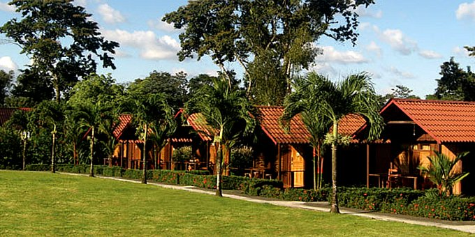 Hotel Arenal Green provides guests with a personal, unique, and  comfortable experience while they vacation in the Arenal area.  This small, ecolodge accommodation is located  in front of the astonishing Arenal Volcano, making it a great choice for nature  lovers and the outdoorsy type. Lodge amenities include restaurant, gardens,  wireless internet, secure parking, and safety deposit box.  The location is unmatched as far as hiking  and scenery is concerned, for the property is within hiking distance of La  Fortuna Waterfalls and Cerro Chato and has views to jungle covered mountains as  well as the volcano.