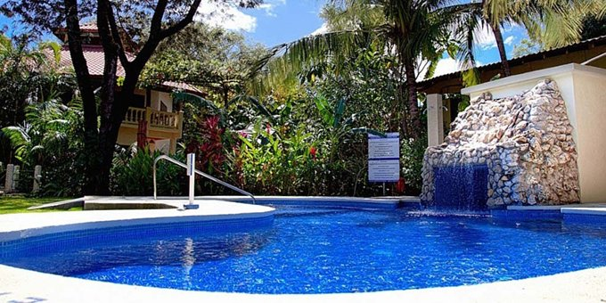 Harbor Reef Lodge is an eco-hotel located in Nosara, three minutes from Playa Guiones.  Hotel amenities include  swimming pools, WiFi, and a rustic jungle setting.