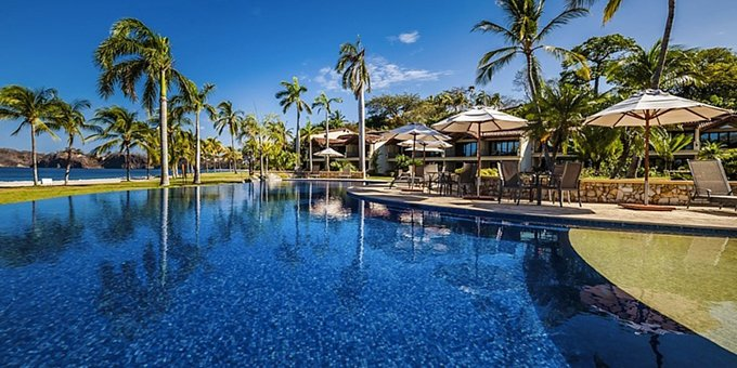 The Palms at Playa Flamingo is a community of luxury rental villas located in front of the gorgeous Flamingo Beach. Guests of the Palms can expect some of the finest vacation rentals in Costa Rica. In addition to beach access, the Palms at Playa Flamingo offer a swimming pool, spa, fitness room, bar, laundry facilities, spa, onsite parking, tropical gardens and Wi-Fi for guest use. Please note this property has different payment and cancellation policies than most other properties in Costa Rica. Please ask your agent for details.