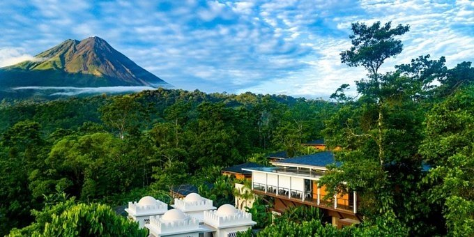 Rated as the Number 10 Hotel in the World by Travel and Leisure magazine in 2018, Nayara Springs is sure to be the intimate romantic setting you are looking for. Located within Arenal Volcano National Park in northwestern Costa Rica, the hotel features a variety of restaurants, 2 large swimming pools, modern gym, nature trails, yoga pavilion, complimentary yoga, and spa. The Spa at Nayara Springs achieved the Number 1 Spa in the World rating in 2016 by Conde Nast Traveler. Complimentary breakfast can be served in your room and laundry service is included. A special staff member will be appointed to assist you during your stay. Your private villa includes your own natural hot spring fed plunge pool, an indoor and outdoor shower, plus daybed and small dining area on your balcony.