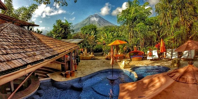 Rated one of the Top 100 Best Hotels in the World in 2018 by Travel & Leisure magazine, Nayara Resort, Spa & Gardens delivers an elegant, unforgettable back to nature Costa Rican experience. Separate private well-appointed villas, strategically positioned opposite the iconic Arenal Volcano, provide spectacular views and scenery. Complimentary daily breakfast, wifi, yoga, bird watching, and a state-of-the-art gym all offer amazing vistas. Hotel amenities include several quality restaurants, outdoor swimming pools, Jacuzzis, nature trails, bird watching, laundry service, and luxury Spa.