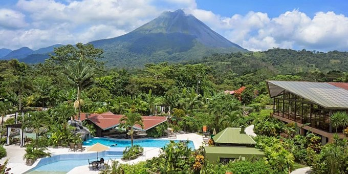 Enjoy authentic Costa Rican charm and thermal hot springs at the Arenal Springs Resort and Spa of La Fortuna. Located across from the majestic Arenal Volcano, this highly rated eco-resort delivers incredible views, lush tropical gardens, and private hot springs exclusively to their guests. The friendly staff will never allow you to forget that you are in Costa Rica. Guests are greeted with warm smiles and the service in all aspects is delightful. Resort amenities include thermal hot springs, spa, swimming pool for adults, kids pool, Jacuzzi, lounge chairs, sun deck, restaurant, pizza bar, sushi bar, wet bar, souvenir shop, Wi-Fi internet access in some public areas, yoga platform and a conference room. As an additional treat if you book your vacation through us, the Arenal Springs Resort offers a special 15% discount per person on their Spa treatments for Pacific Trade Winds guests.