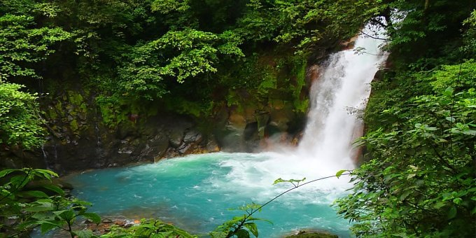 With spectacular turquoise blue waters and matching morpho butterflies fluttering around, natural hot springs and jungle trails that lead to one of Central America's most stunning waterfalls, Rio Celeste (meaning Light Blue River in Spanish) is one of Costa Rica's best kept secrets.